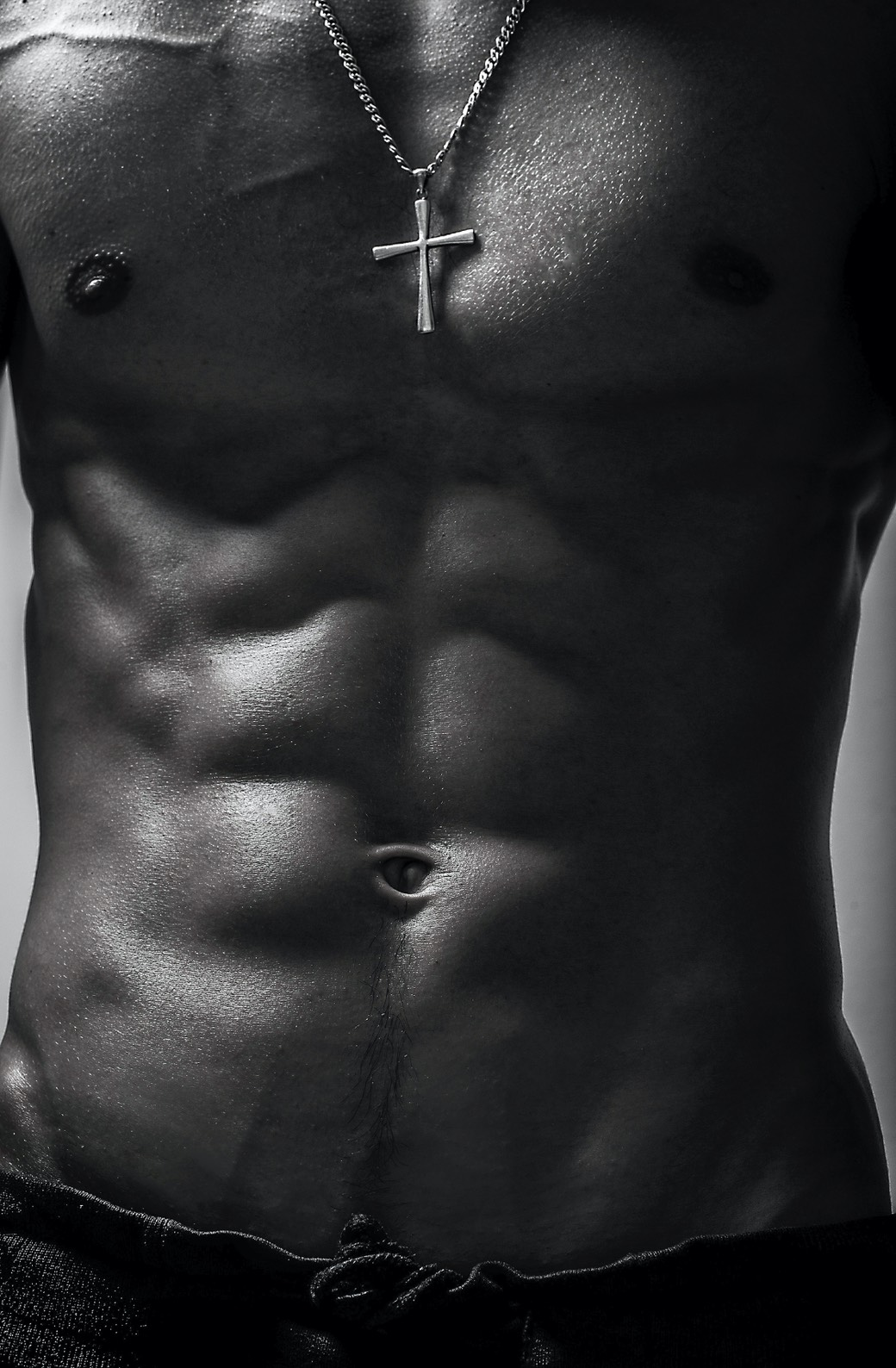 athletic male with cross