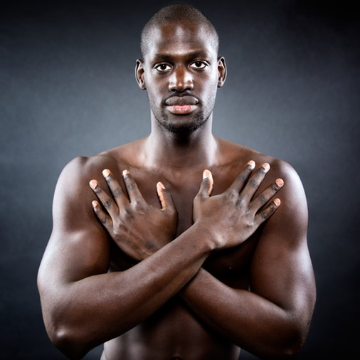 Black man with arms crossed